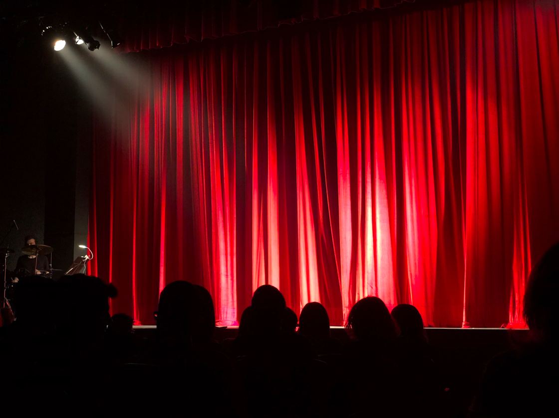 A red curtain at a theatre performance, highlighting how important it is to define your target audience in e-commerce copywriting.