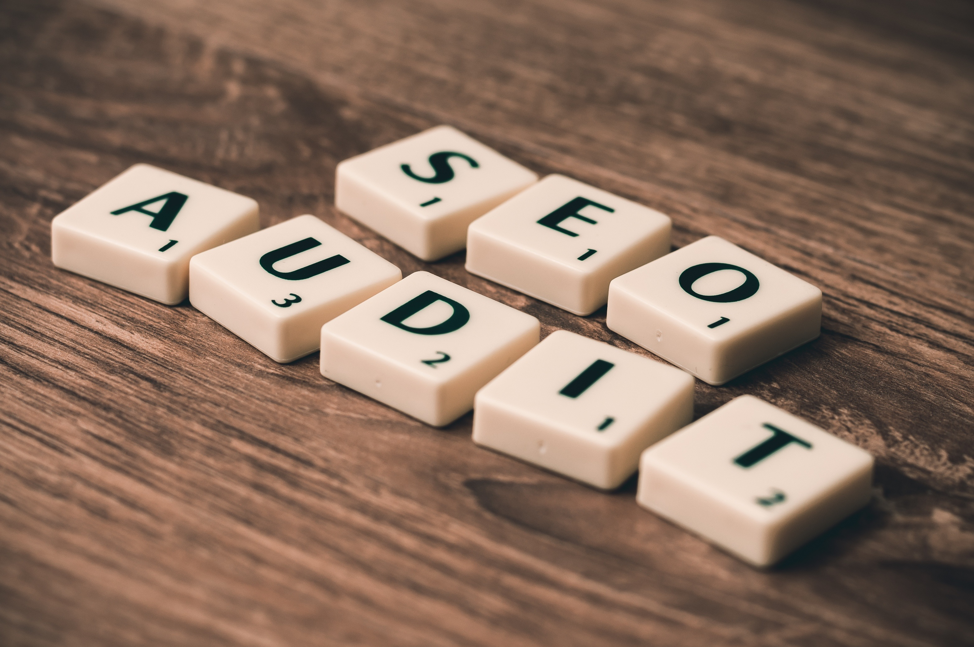 """An image showing scrabble letters which spell out """"SEO audit"""". Monitoring and updating your SEO is crucial for e-commerce success."""
