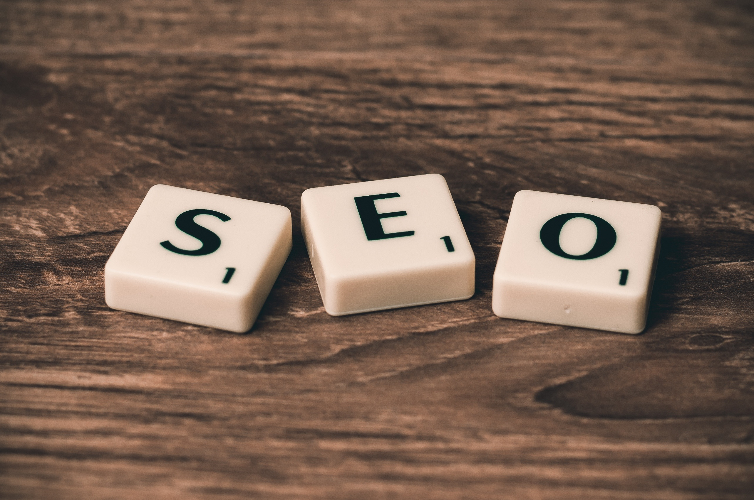 "An image showing ""SEO"" in scrabble letters. SEO is a key element of your e-commerce marketing strategies and should be consistently revisited and improved."