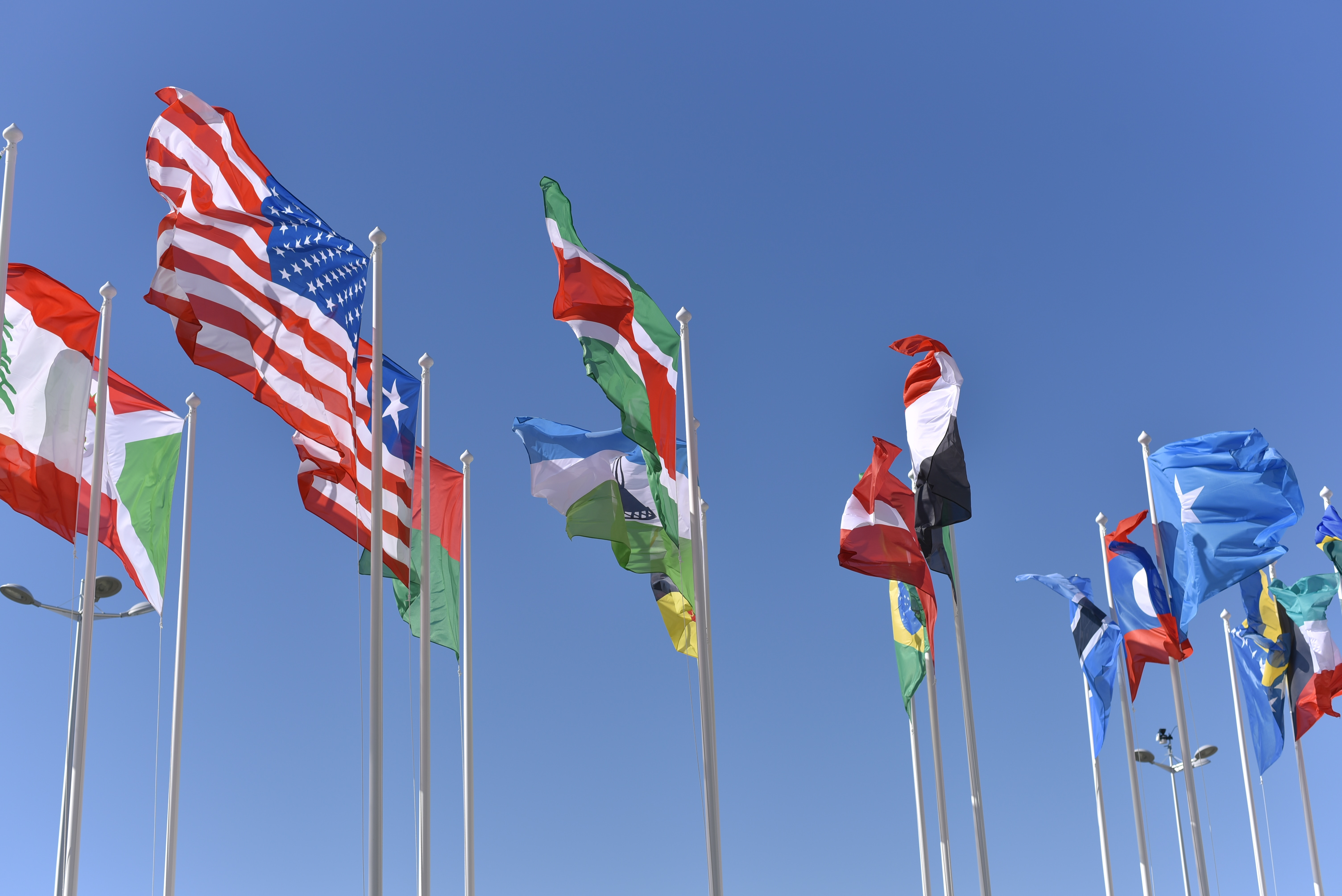 An image showing flags of different nations, all of which can be reache with a good multilingual SEO strategy.