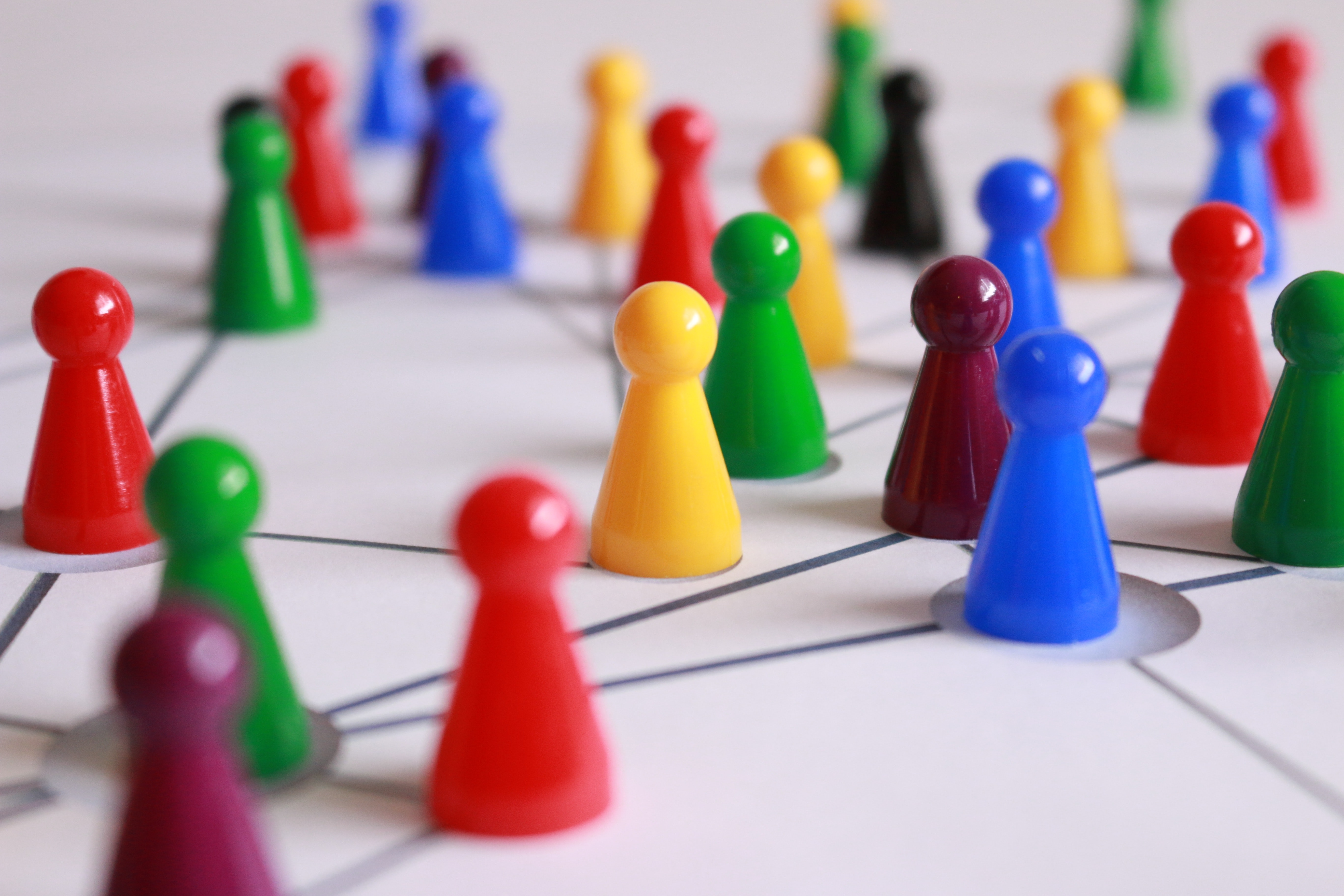 Image showing players connected on a board game, much like those in a brand community.