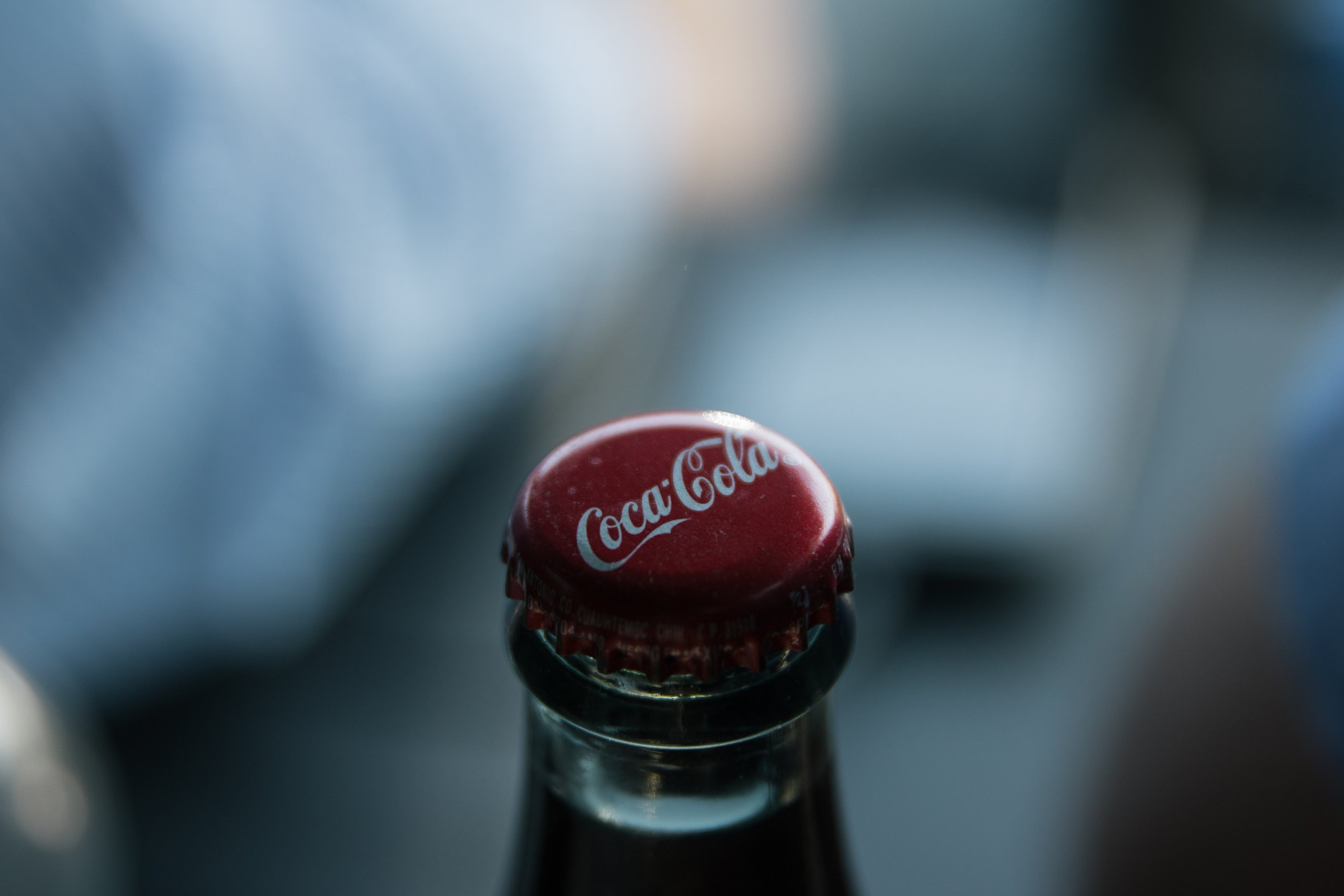 Image showing a Coca-Cola bottle cap, whose red colour is often referred to in e-commerce colour psychology.
