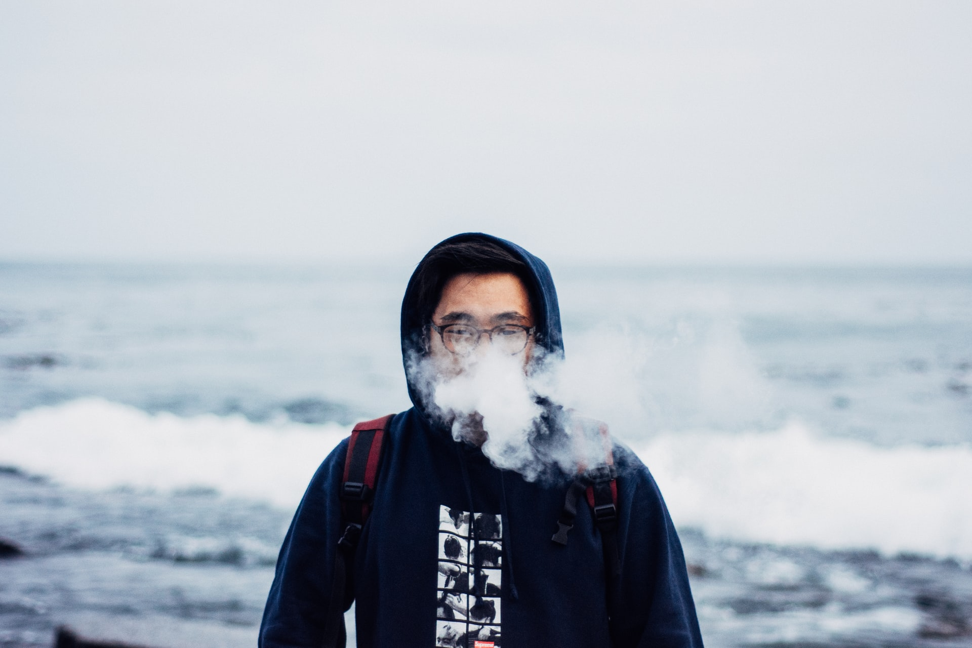 Selling vaping products online? Man vaping by the seaside.