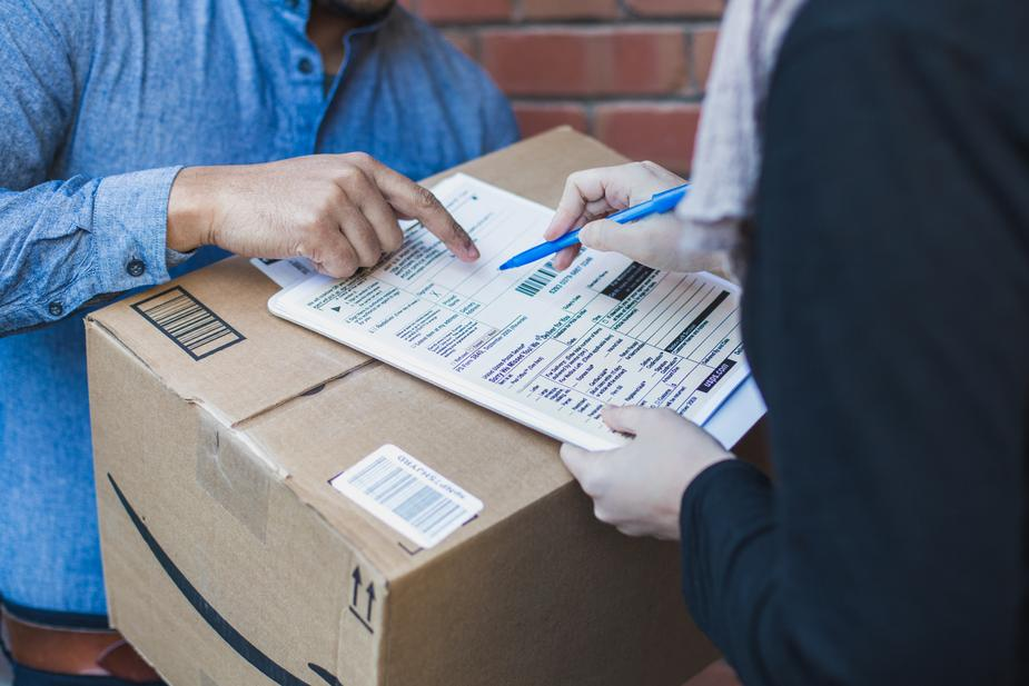 Person signing for a parcel delivery