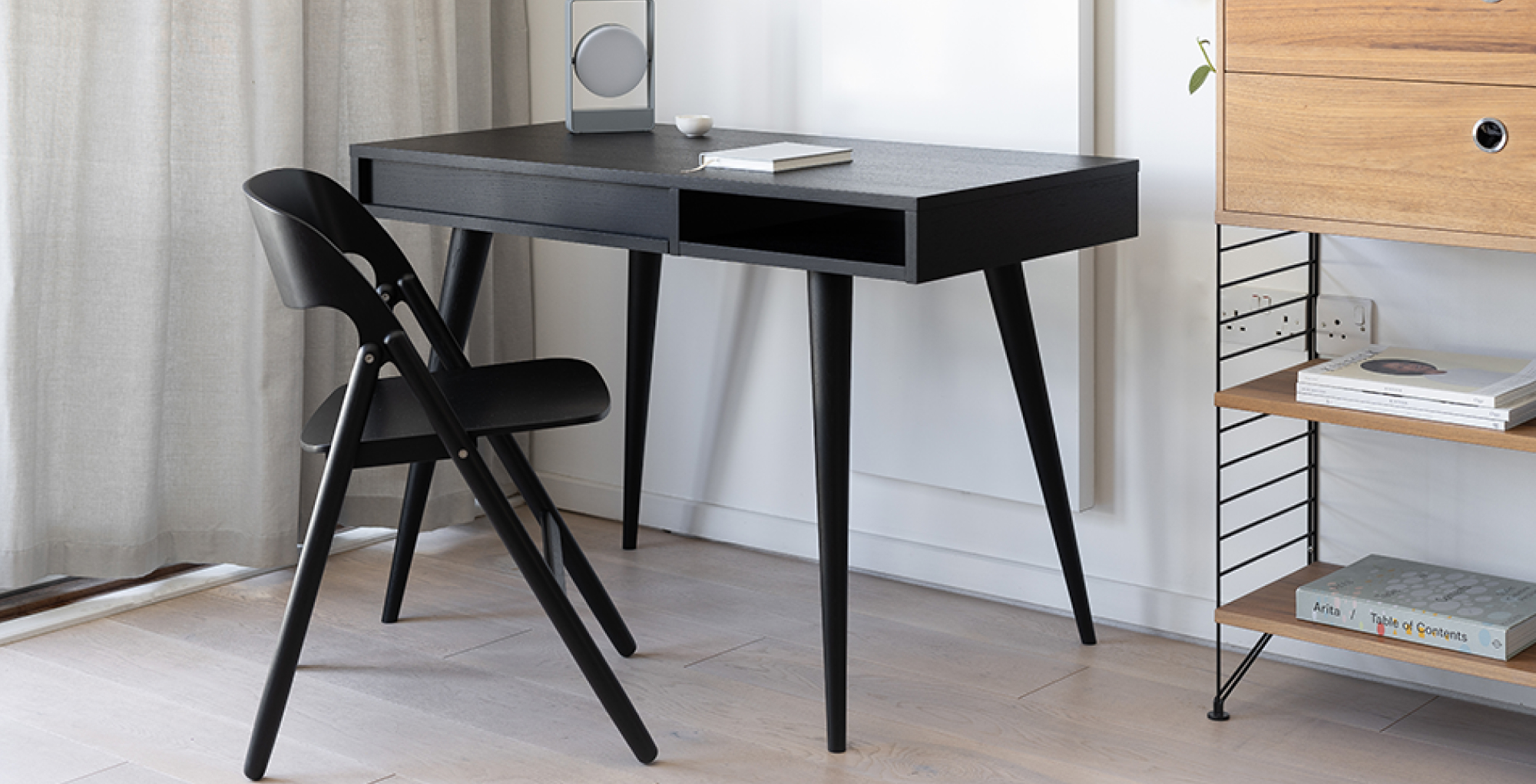 black wooden desk and table